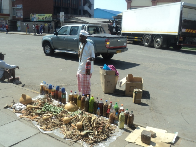 """A """"Chivanhu"""" vendor displays his wares in Harare Central"""